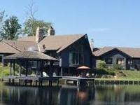 Secluded Lakefront Rural Estate on 10.53 acres. A stone