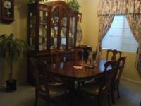 Nice 6 chair dining table with a matching hutch/buffet.