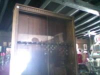 7 ft gun cabinet. will hold up to 12 rifles. Call  or