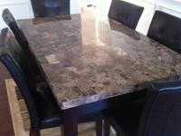 6 leather chairs and granite dining table for sale. 8