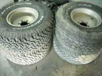 selling a set of chevy wheels , 2 tires are new and 2