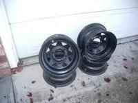 4 six lug steel wheels, flat black, 15x8 call  or
