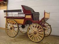 roberts burgandy 6 passenger wagonette. Used in a