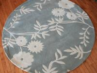 6 ft round rug. Blue/white floral.  Rug is Made of: 100