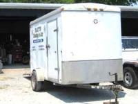 6 x 12 cargo trailer, 7 ft. ceilings, ramp and side