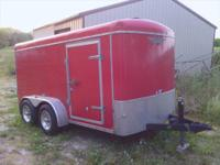 This is a 2001 6 x 12 H&H red trailer with e-tracks ,