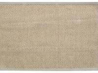 Developed with a linen border, this woven rug has a