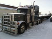 Peterbilt 379 with Watson 13,200 lb. lift axle.