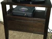 This beautiful wood TV stand was originally purchased
