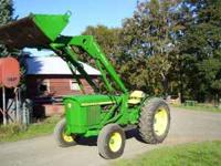 John Deere 2030 tractor with loader ready to go to