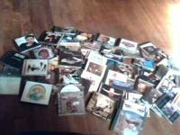 60 music cds mostly country n rock from the 80s n 90s