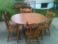 Nice wood dinning set includes 4 chairs and 1 table.