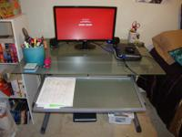 Glass desk with metal framing, also has a pull out