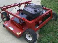 "60"" PULL BEHIND SWISHER FINISH MOWER WITH A 13.0 HORSE"