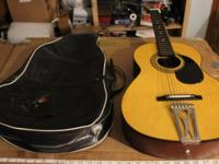 I have a parlor size acoustic made by Kingston.