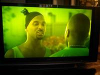 "60"" Sony flat screen TV, has small green tint to it,"