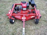 VERY HANDY MOWER THAT IS READY TO MOW. HAS THE LARGER
