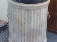 THE IS A GREAT OLD STYLE GARBAGE CAN FROM AROUND THE