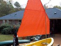 I have a fiberglass sailing dinghy and trailer. 13