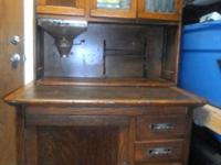 "A Hoosier cabinet (also known as a ""Hoosier"") is a type"