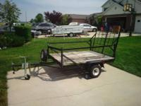 For sale is a 4 x 6 utility trailer with fold-down