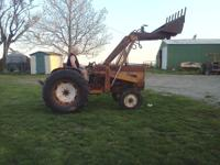 This tractor runs great it's a gas loader works well