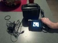 60gb HD jvc emerio camcorder and can take pics off it