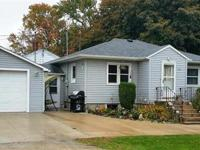 This well maintained 2 bedroom home on a corner lot is