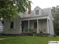 This terrific 1 ½ story home is located in a