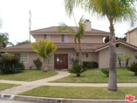 This spacious 4 bedroom 4 bath home on a sweeping
