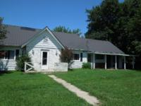 Fixer Upper with 0.40 of an ac with a 2 story ranch