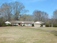 3 bedroom, 1 1/2 bath, brick home located in Magnolia,