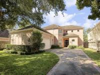 Located on large treed lot, this custom built home is