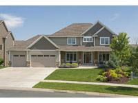 Stunning 2-sty walkout w/new roof & gutters, situated