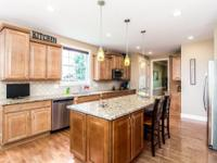 Exceptional 5-level split home features a gracious,