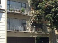 Low maintenance 8-unit apartment building faces San