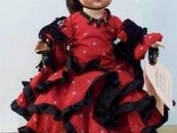 Miss Spain is wearing a ruffled red cotton dress with