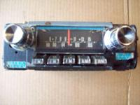 This is a original factory AM/FM Radio # F4TBE 002327,