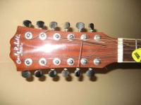 Nice twelve strings Carlo Robelli acoustic guitar. I