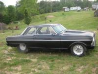 Black 65 Chevy Nova available for sale! Big tire car.