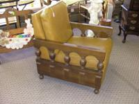 Nice condition vintage naugahyde and wood arm chair. It