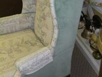 Good condition used upholstered wing back chair from