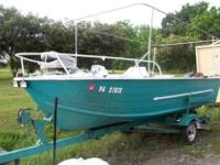 Here's a 17 foot boat with a motor and trailer. The