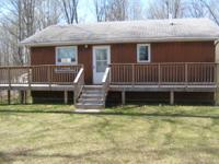 Split level lake home ignoring Otter Lake. Sleeps 6