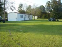 16x80 3bd/2ba MH located in Wilmer on 100'x300' lot.
