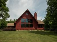 Nestled among 350 plus acres of prime timberland in the