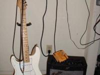 Left Handed Fender Stratocaster and a Mustang 1 amp by