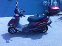 This is a (barely) used 50cc Scooter. This runs and