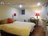 The bedroom is furnished with a full size bed, a desk,