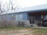 Older home with 12'x30' carport on hyway 66,2 bedroom,